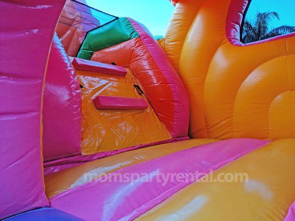 unicorn fairytale inside bounce house rental