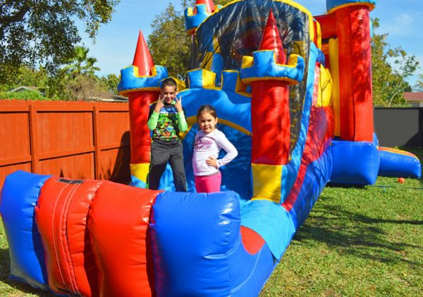 kids playing in bounce house