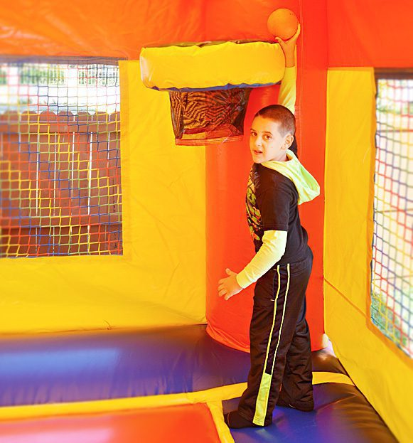kids playing in royal bounce house