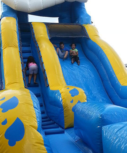 kids sliding down the slide